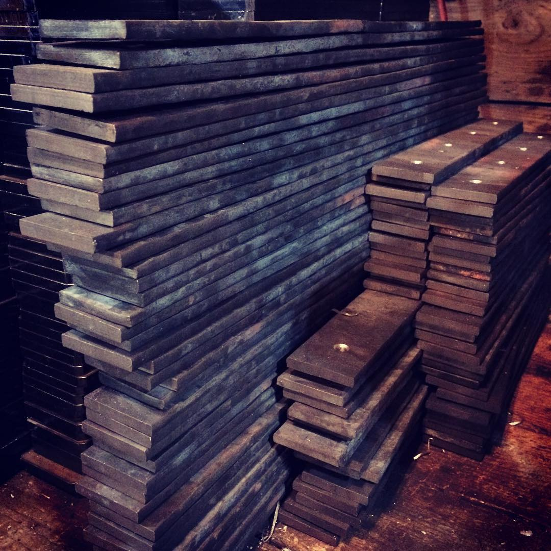 A pile of textured steel and approximately 1200 holes ready to be bent into shelf brackets. #blacksmith #forged #madeincanada