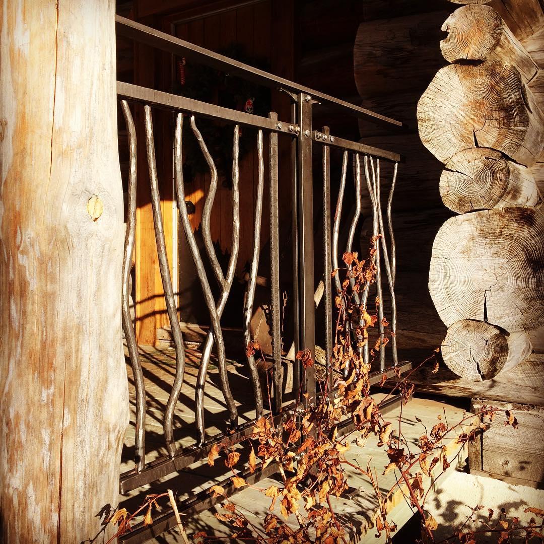 Sample railing finished. #blacksmith #forged #rivet #loghome #railing
