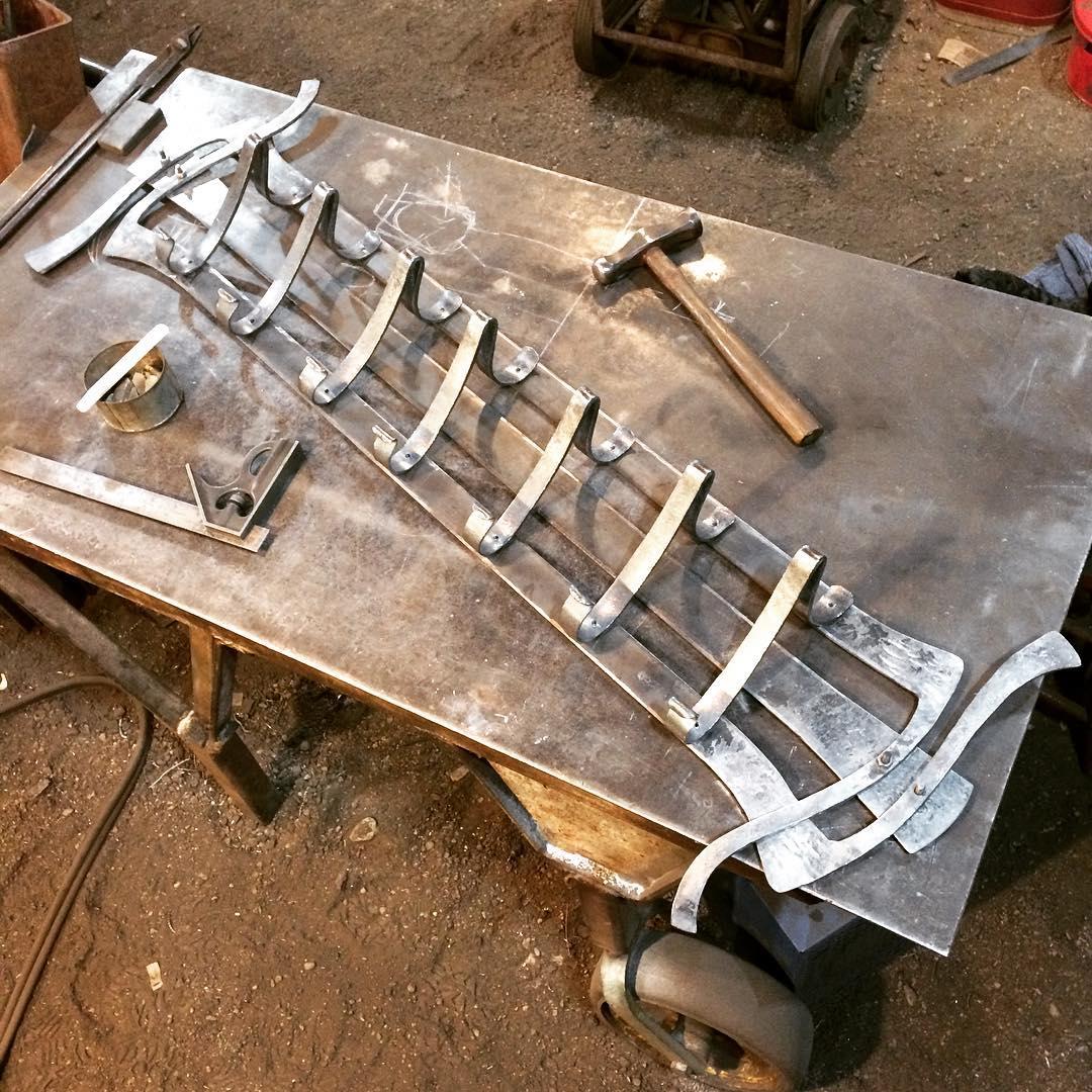 Tomorrow we will rivet this #coatrack together and finish it up. #blacksmith #winnipeg #manitoba #forged #artnouveau #scroll