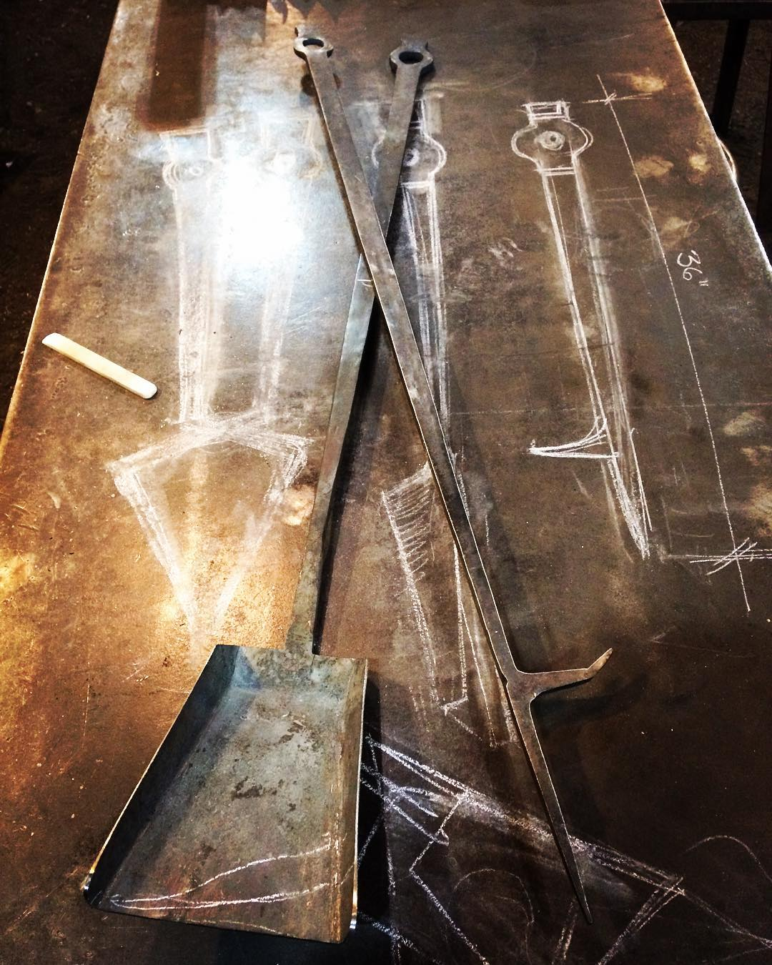 Custom fire tool set for a modern triangular fire pit. Because of the simple lines in wanted to avoid rivets on the shovel pan. So it was fire weld on and hammered out the sheet.  #thehardway #forged #traditional #technique #modernform #winnipeg